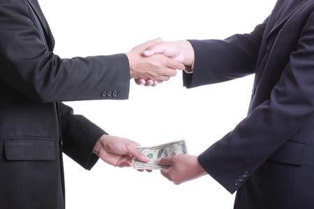 dare soldi: Imprenditore dare i soldi per la corruzione qualcosa con sfondo bianco Archivio Fotografico