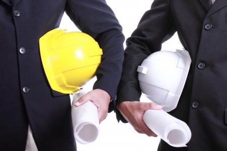 Two Engineer people holding safety hat for work thier project with teamwork concept photo