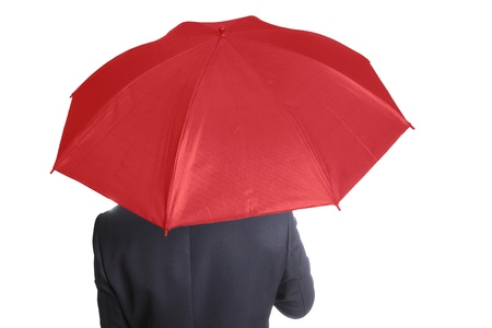 Businessman holding red umbrella with white background photo