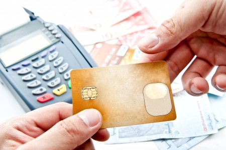 macchina di pagamento e la carta di credito in un supermercato Archivio Fotografico