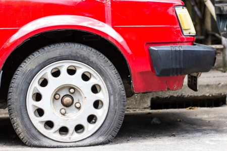 Close up Flat tire on the road waiting for repair photo