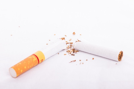 stop your smoke with concept bend Cigarette with white background  photo
