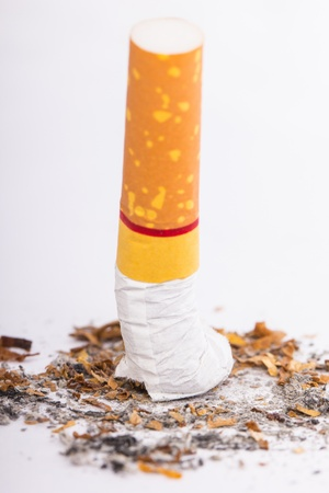 Cigarette butt with white background photo