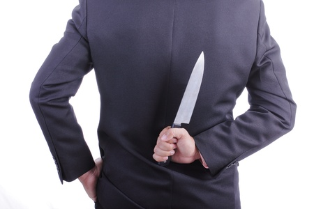 double cross: Businessmans holding knife with white background