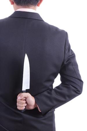 double cross: Businessmans in possesso di coltello con sfondo bianco Archivio Fotografico