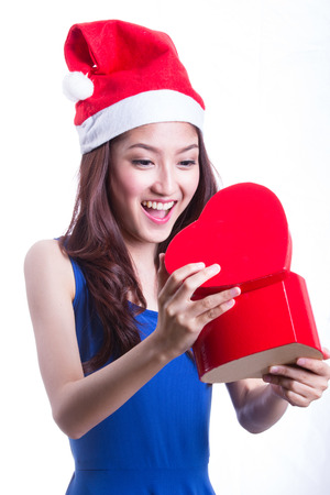 Lovely Asian girl hold gift on chirstmas day photo