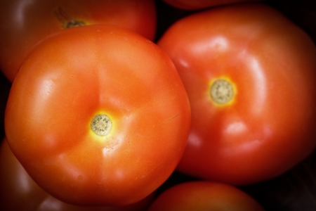 Close up Red tomatoes in the market photo