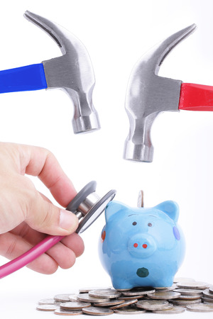 refunds: Check your money before use Hold Hammer to hit piggy bank for refinance or refunds your money to use something Stock Photo