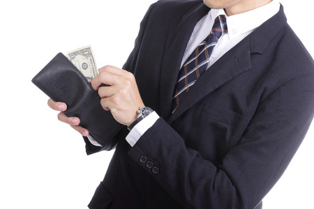 Businessman putting dollar money for pay something with white background photo