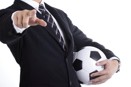 Football manager hold ball for command player for follow as planning photo