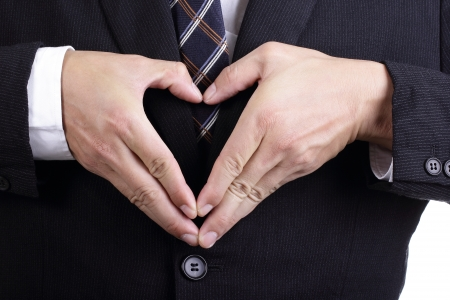Businessman use his hand for show heart symbol in the office photo