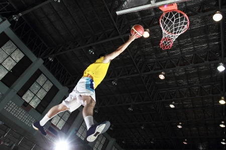 layup: Basketball player layup for score in the game Stock Photo