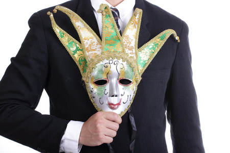 Businesman holding white mask with isolated photo