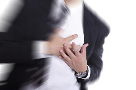 Heart Attack, gebruiken hand grijpen een kist met een witte achtergrond Stockfoto