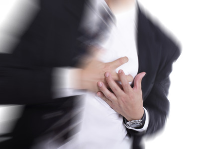 heartsick: Heart Attack ,Use hand grabbing a chest with white background Stock Photo