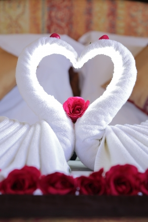 sweet heart: Close up sweet heart white cloth on the bed of hotel