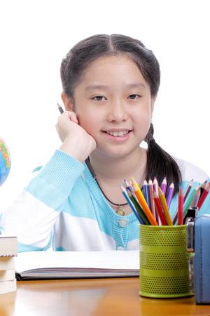 Student girl doing homework in school photo