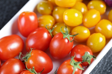 newsgroup: Close up Red tomatoes with another vegether