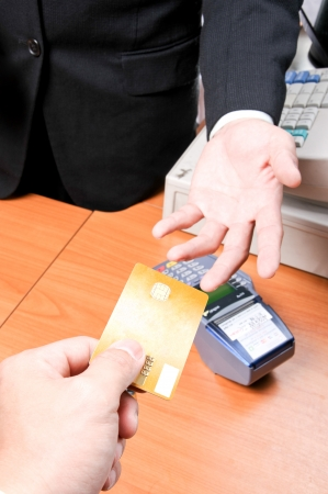 Businessman give credit card for pay something in super market photo