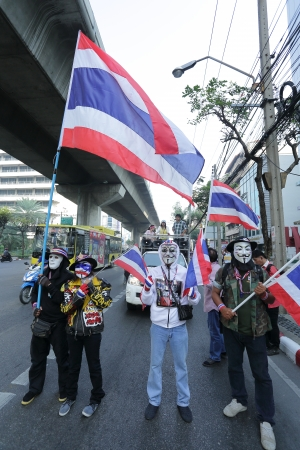 occupy movement: BANGKOK - DEC 9: Many Masked protesters walked for anti government corruption on December 09, 2013 in Bangkok, Thailand. The protesters required Yingluck Shinawatra Prime Minister resign. Editorial