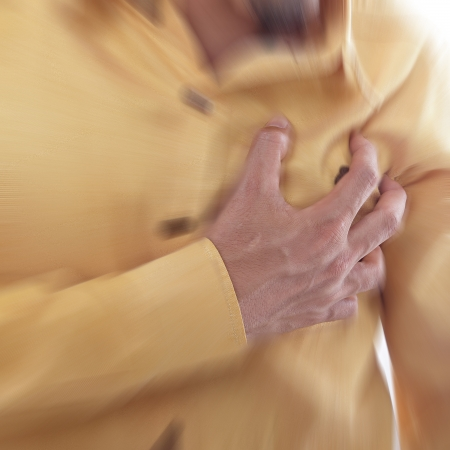 palpitation: Heart Attack ,Use hand grabbing a chest with white background Stock Photo