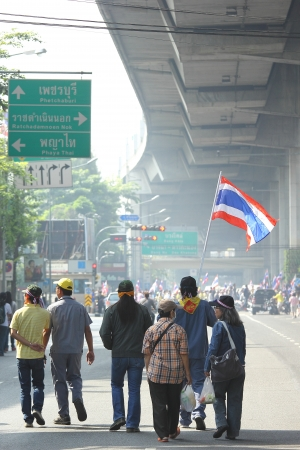 milion: BANGKOK - DEC 9  Many 5 milion people walked for anti government corruption on Jun 09, 2013 in Bangkok, Thailand  The protesters required Yingluck Shinawatra Prime Minister resign  Editorial
