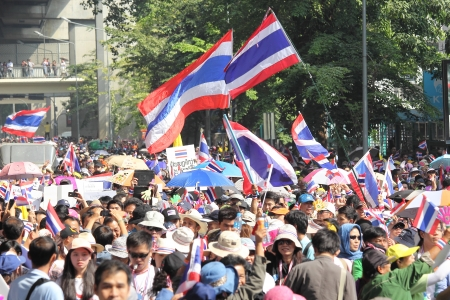 occupy movement: BANGKOK - DEC 9: Many 5 milion people walked for anti government corruption on Jun 09, 2013 in Bangkok, Thailand. The protesters required Yingluck Shinawatra Prime Minister resign. Editorial