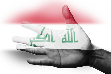 iraq flag: Cheering fan with Painting national Iraq flag with your hand with your hand for cheer your national sport