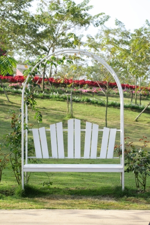 White Iron Armchairs beside road in Thailand garden photo