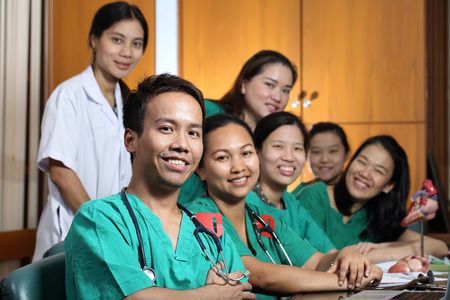Medical Group studying Cardiologist in Classroom photo