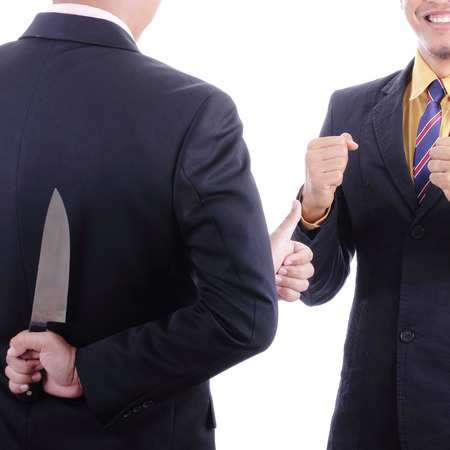 discussed: Businessmans show thumbnail for cheerful  after discussed while another people holding knife for double-cross