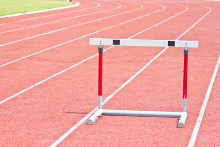 hurdling: hurdles on the red running track prepared for competition.