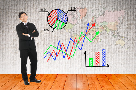 Businessman looking graph business for explain something photo