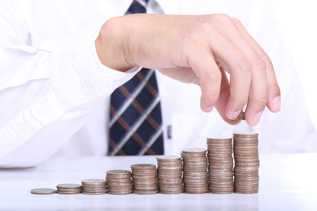 Businessman put coin stack money for money growth concept  photo