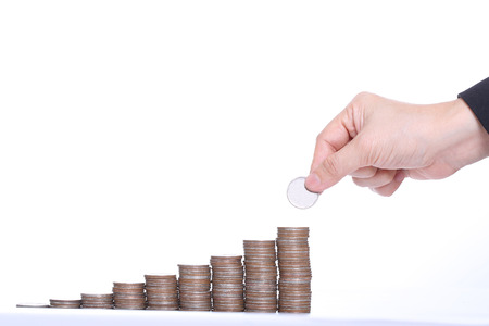 Business women put coin stack money for money growth concept photo