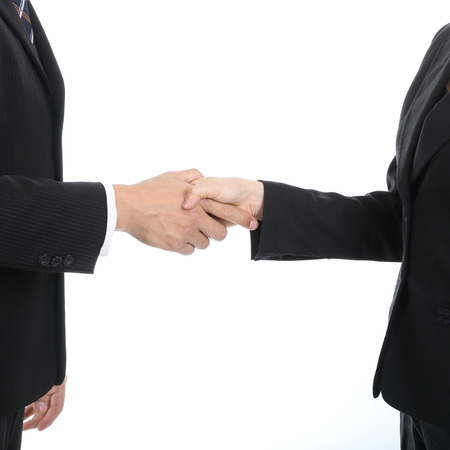 thier: Businessman handshake for good relationship with thier marketing. Stock Photo