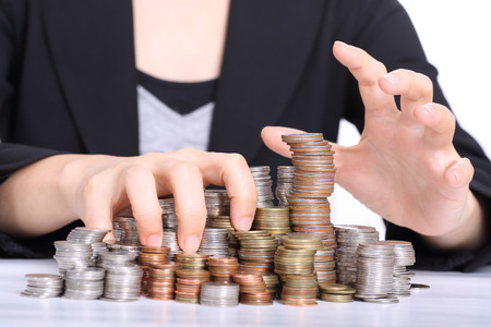 rapacity: Women office used hands on the coins Stock Photo
