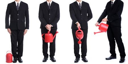 Businessman hold red watering pot photo
