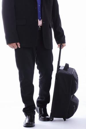 Travel businessman holding luggage photo