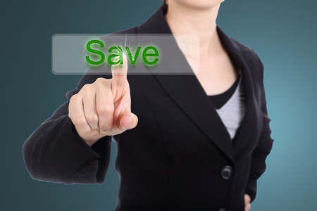 buttom: Business woman touch  Save  buttom with virtual screen Stock Photo