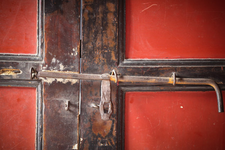Close up red ancient locker door  in Chinese temple photo