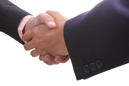 discussed: businessman shaking hands after finished discussed