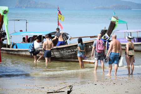long tailed boat: KRABI,THAILAND - CIRCA JANUARY 2013 - Traveler came to travel in high season by Thai Long tailed boat at Ao Nang circa January in Krabi, The center boat  transportation by sea in 2013  Editorial