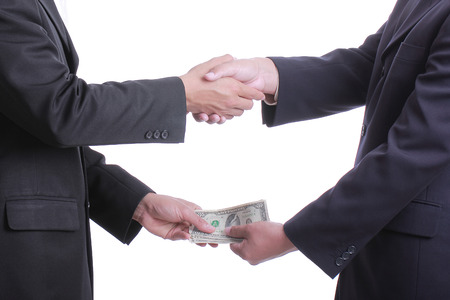 Businessman give money for corruption something and accepted  photo