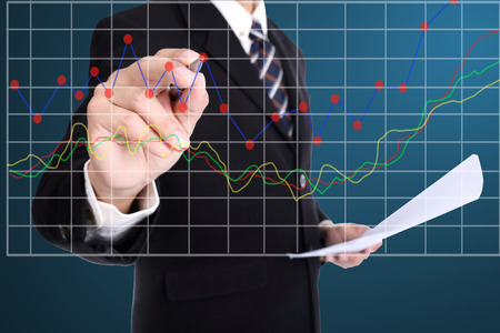 taget: Businessman write growing graph for check his taget