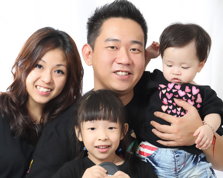 Asian Family portrait inside home with white background photo