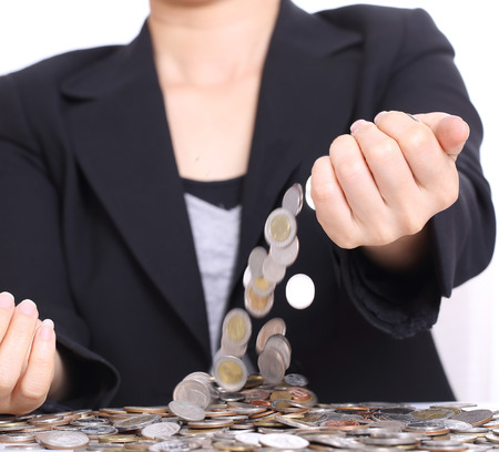 Women take money up for investment in the future photo
