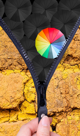 Open zip to show Leader holding multiple color umbrella for show different think  photo
