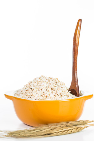 Oat flakes pile on the white background photo