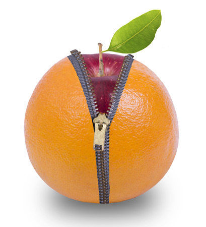 unzip: Unzip orange fruit show red apple inside with white background